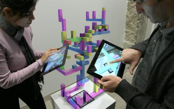 Graduate students interacting with Professor Price's ConstructAR app.