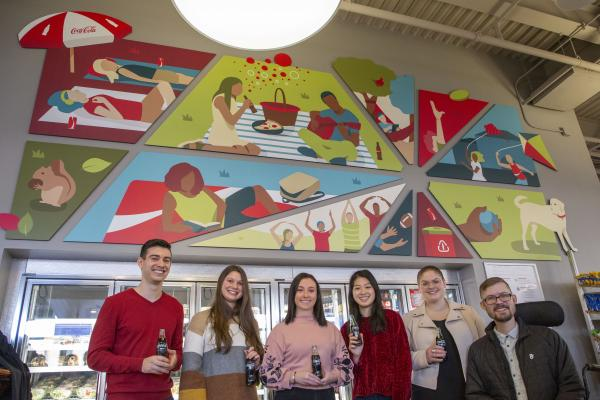 1.	Image of 6 students underneath the mural
